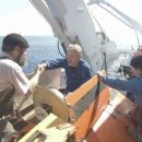 MIR crew members help James Cameron (center) into MIR 1