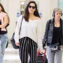 Olivia Munn at Heathrow Airport in London - 454 x 681