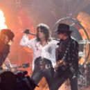 Actor/musician Johnny Depp, singer Alice Cooper and musician Joe Perry of Hollywood Vampires perform onstage during The 58th GRAMMY Awards at Staples Center on February 15, 2016 in Los Angeles, California. - 454 x 288