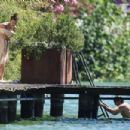 PICTURE EXCLUSIVE Irina Shayk displays her slender supermodel body in a black string bikini as she enjoys swim with shirtless hunky beau Bradley Cooper during romantic Lake Garda getaway