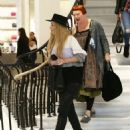 Iggy Azalea does some shopping at Barneys New York in Beverly Hills, California with her bodyguard on January 16, 2015