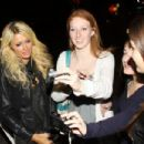 """Paris and Nicky Hilton spot an ad for Paris's """"Best Friend Forever"""" TV show as they leave Lucky Strike bowling alley"""