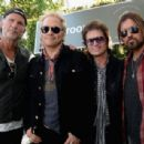 Chad Smith of Red Hot Chili Peppers, Matt Sorum, Glenn Hughes and Billy Ray Cyrus attend the John Varvatos 12th Annual Stuart House Benefit at John Varvatos on April 26, 2015 in Los Angeles, California. - 454 x 308
