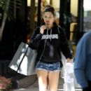 Adriana Lima in Shorts – Christmas Shopping at Ball Harbor in Miami - 454 x 681