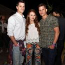Actors Max Carver, Charlie Carver, and Holland Roden attend the NYLON Midnight Garden Party at a private residence on April 10, 2015 in Bermuda Dunes, California