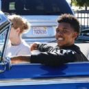Nick Young and his rapper girlfriend Iggy Azelea ride in style to grab some Chick-fil-A in Los Angeles California on December 23, 2014 - 454 x 303