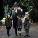 Pierce Brosnan as Desmond Doyle, getting to see his daughter Evelyn (Sophie Vavasseur) and sons Dermot (Niall Beagan) and Maurice (Hugh McDonagh) in MGM's Evelyn - 2002 - 454 x 297