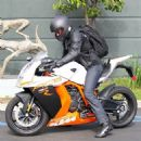 Bradley Cooper rides off on his motorcycle after shopping at Soul Cycle on August 7, 2013 in Brentwood, California