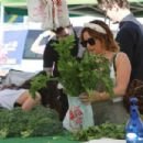Ashley Tisdale – Shopping at the local farmers market in Los Angeles