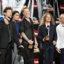 Metallica pose in the press room during the 24th Annual Rock and Roll Hall of Fame Induction Ceremony at Public Hall on April 4, 2009 in Cleveland, Ohio - 454 x 334