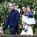 Prince William, Duchess Catherine, George and Charlotte at a children's party