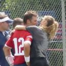 Gisele Bundchen and Tom Brady – Share a kiss in Foxborough