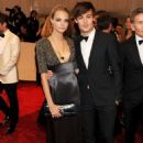 Model Cara Delevigne and actor Douglas Booth attend the