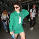 Charli XCX in Green – Arriving at the Kings Cross St Pancras Station in London - 454 x 687