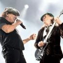 Brian Johnson and musician Angus Young of AC/DC perform at Dodger Stadium on September 28, 2015 in Los Angeles, California. - 454 x 324