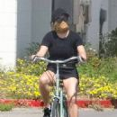 Reese Witherspoon – Riding a bicycle while her husband jog
