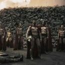 Astinos (TOM WISDOM, third from left), Leonidas (GERARD BUTLER) and his Captain (VINCENT REGAN) look toward the distant Persian encampment as a wall of the day's dead rises behind them in Warner Bros. Pictures', Legendary Pictures' and V - 454 x 194