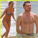 Sam Worthington & Lara Bingle Show Off Beach Bodies in Hawaii