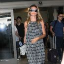 Heidi Klum and her boyfriend touch down at LAX airport in Los Angeles, Califronia on July 31, 2016 - 454 x 510