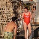 Lindsay Lohan – In red swimsuit on Mykonos Island - 454 x 681