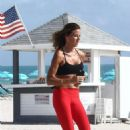 Kelly Bensimon in Red Tights – Jogging on the beach in Miami - 454 x 681