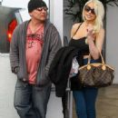 The day after Courtney spent the night cosying to the much older Edward Lozzi. She stepped out with her estranged husband Doug Hutchison in Beverly Hills, California