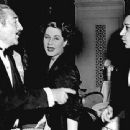 Norma Shearer and George Raft  Shearer trying to break up this fight between Adolphe Menjou and George Raft - 454 x 339