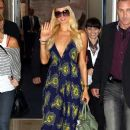 Paris Hilton arrives on a flight in Sydney, Australia on March 29, 2012