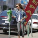 Lily Collins feeding the parking meter in Beverly Hills - 454 x 541