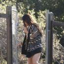 Vanessa Hudgens tries to hide from the camera as she is spotted leaving a psychiatrist house after treatment in Santa Monica, California on December 27, 2013
