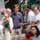Megan Dayton (Bonnie Hunt), Bob Rueland (David Duchovny), Charlie Johnson (David Alan Grier) and Joe Dayton (James Belushi) at a party hosted by Grace Briggs (Minnie Driver) in MGM's Return To Me - 2000 - 240 x 400