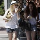 Dakota Fanning enjoyed a lunch date with her friend at  a local eatery in Los Angeles, California on August 23