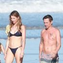 Gisele Bundchen in Black Bikini – Takes a Morning Walk on the Beach in Costa Rica - 454 x 890