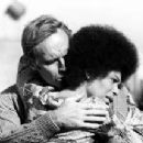 Charlton Heston and Rosalind Cash