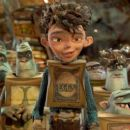 Eggs (center, voiced by Isaac Hempstead Wright) is surrounded by his Boxtroll friends in. LAIKA and Focus Features' family event movie THE BOXTROLLS,