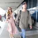 Paris Hilton and Chris Zylka at LAX Airport in Los Angeles - 454 x 606