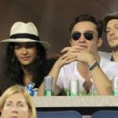 Ed Westwick and Jessica Szohr give the crowd plenty to gossip about as they are spotted kissing and quaffing at the US Open