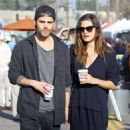 Phoebe Tonkin and Paul Wesley hold hands out in Studio City
