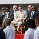 Prince Harry chats with a young girl at a youth rally held at National Stadium on Monday (March 5) in Nassau, the Bahamas
