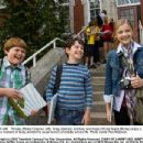 Rowley (Robert Capron, left), Greg (Zachary Gordon) and Angie (Chloë Grace Moretz) enjoy a rare moment of levity amidst the usual horrors of middle school life. Photo credit: Rob McEwan - 454 x 348