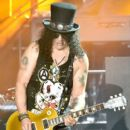 Musician Slash of Guns N' Roses performs onstage during day 2 of the 2016 Coachella Valley Music & Arts Festival Weekend 1 at the Empire Polo Club on April 16, 2016 in Indio, California. - 399 x 600