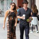 Nikki Reed and Ian Somerhalder walk hand in hand while stopping for coffee in Beverly Hills, California on September 8, 2014