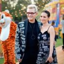 China Chow and Billy Idol attend the Moschino Spring/Summer 19 Menswear and Women's Resort Collection at Los Angeles Equestrian Center on June 8, 2018 in Burbank, California - 454 x 312