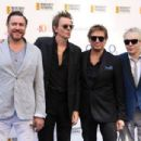 Simon Le Bon, John Taylor, Roger Taylor and Nick Rhodes of Duran Duran attend the Nordoff Robbins 02 Silver clef Awards at The Grosvenor House Hotel on July 3, 2015 in London, England. - 454 x 304