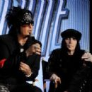 Musicians Nikki Sixx (L) and Mick Mars speak onstage to announce their upcoming Motley Crue and KISS co-headlining tour at the Hollywood Roosevelt Hotel on March 20, 2012 in Los Angeles, California