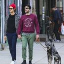 Zachary Quinto and Miles McMillan take their dogs for a walk in the East Village neighborhood of New York City NY on October 17, 2016