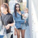 Kourtney Kardashians, along with North West, Mason Disick, Reign Disick, and Penelope Disick attend a birthday party in Studio City, California on May 14, 2016