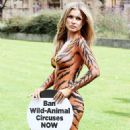 Joanna Krupa – Bodypaint while protesting outside Westminster in London - 454 x 605