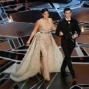 Actors Gina Rodriguez and Tom Holland speak onstage during the 90th Annual Academy Awards at the Dolby Theatre at Hollywood & Highland Center on March 4, 2018 in Hollywood, California.