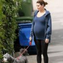 Heavily pregnant Jamie-Lynn Sigler keeps active as she takes her beloved pup for a hike